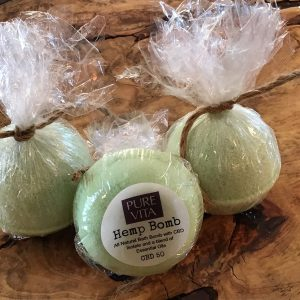 Light green round hemp bath bombs in packages